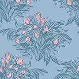 与郁金香的无缝的墙纸样式在花瓶 免版税库存照片