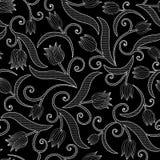 与郁金香的无缝的样式在黑背景 图库摄影
