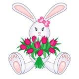 与郁金香花束的兔宝宝  免版税图库摄影