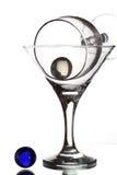 与酒杯和玻璃珠的仍然生活在白色背景 免版税库存照片