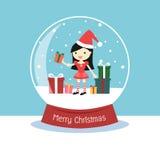 与里面圣诞老人妇女和礼物盒的雪地球 图库摄影