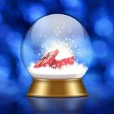 与里面礼物盒的雪地球 免版税库存图片