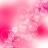 与重点和闪闪发光的紫色bokeh背景 库存照片