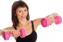 与重量的适合的女孩训练。 库存照片