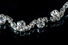 与金刚石的珠宝在黑背景 免版税库存照片