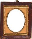 与金子修整的长圆形的老古色古香的照片框架 库存图片