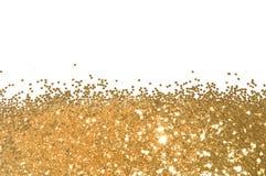 与金子闪烁闪闪发光的背景在白色,装饰亮晶晶的小东西 免版税库存照片