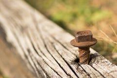 与金属钉的风景木材 库存图片