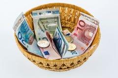 与金钱的篮子从捐赠 免版税库存照片