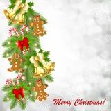 与金铃的圣诞卡在圣诞树的分支 库存照片