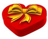 与金黄弓的心形的配件箱礼品的 免版税库存图片