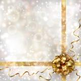 与金黄弓的抽象圣诞节背景 免版税库存照片