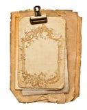 与金黄装饰品的老白纸页 免版税库存图片