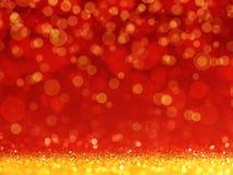 与金黄闪烁或bokeh光的红色圣诞节背景 库存照片