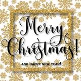 与金黄雪花和词组圣诞快乐的欢乐框架 库存照片