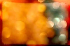 与金黄bokeh和框架的圣诞灯 免版税图库摄影