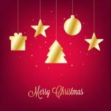 与金黄圣诞节装饰的圣诞快乐卡片在红色背景 免版税图库摄影