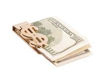 与金黄夹子的美元 库存照片