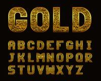 与金黄纹理的拉丁字母 免版税库存图片
