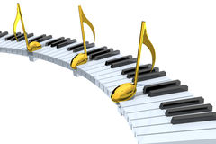 与金黄音符的琴键摘要 库存图片