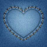 与针的牛仔布纹理以心脏的形式 免版税库存照片