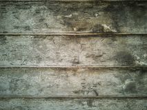 与钉子的老绿色木板条 免版税库存照片