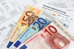 与钞票的工资单 免版税图库摄影