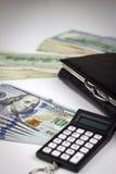 与钱包和计算器的美国美元 图库摄影