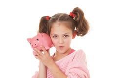 与钱箱储蓄的孩子 免版税库存照片
