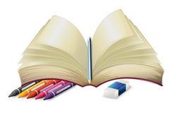 与铅笔、橡皮擦和蜡笔的一本书 免版税库存照片