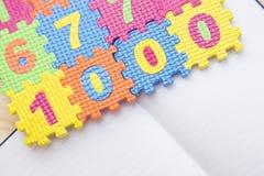与铅笔和colorfull标志的笔记薄 免版税库存照片