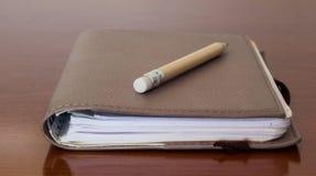 与铅笔的块笔记 库存图片