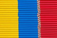 与铅笔的委内瑞拉和哥伦比亚旗子 库存照片