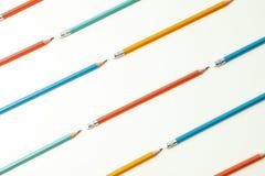 与铅笔的平的被放置的构成在白色背景 免版税库存照片