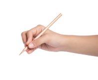 与铅笔的手文字在白色背景 库存照片