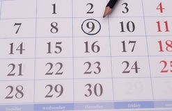 与铅笔的日历笔记的 免版税库存照片