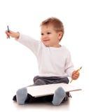 与铅笔的男孩图画 免版税图库摄影