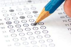 与铅笔的答案纸 免版税图库摄影