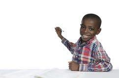 与铅笔,赠送阅本空间的非洲男孩文字 免版税库存图片