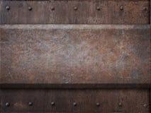 与铆钉的生锈的坦克装甲金属纹理  免版税图库摄影