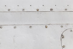 与铆钉的金属表面 免版税库存图片