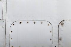与铆钉的金属表面 免版税图库摄影