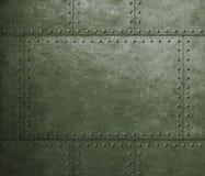 与铆钉的金属装甲军事绿色背景 库存图片