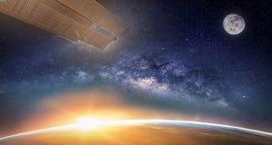 与银河星系的风景 日出,地球,月亮 库存图片