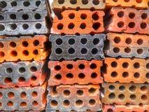 与铸孔的穿孔的砖堆 免版税图库摄影