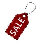 与销售的红色皮革价牌标签发短信 免版税图库摄影