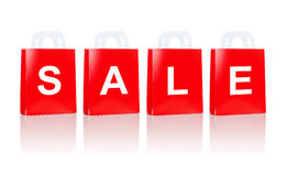 与销售词的许多红色购物袋 免版税库存图片