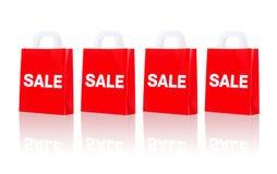 与销售词的许多红色购物袋 库存图片
