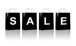 与销售词的许多黑购物袋 免版税库存照片