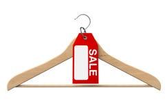 与销售额标签的挂衣架 免版税库存照片